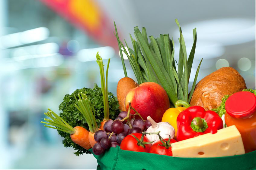 cart of healthy fruit and vegetables and cheeses
